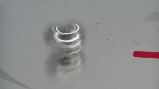 철구슬 2개를 압축공기로 초고속회전시키기